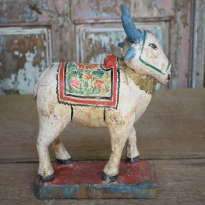 antique carved nandi bull with faded paint
